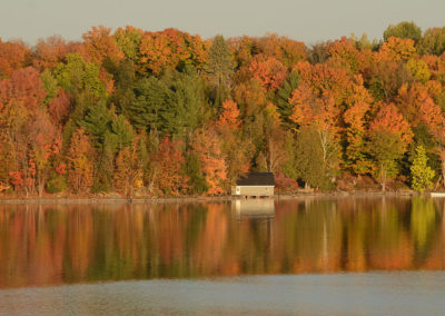 Fall colours with boat house on Wolfe Lake