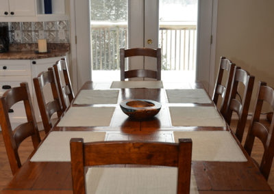 Reclaimed wood and Forest Stewardship Council Certified wood dining table that seats eight