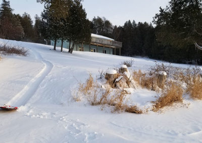 Sledding in winter at Lazy Loon Lakehouse