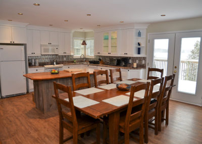 Sparkling clean kitchen with reclaimed solid-wood table for eight