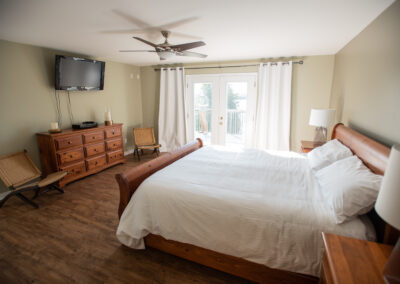 Master bedroom with walkout to 50' deck and ensuite with walk-in closet