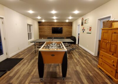 Walkout Games Room (33x16) with foosball table, ping pong table, dart board, 65in Smart TV with Netflix, and lots of board games